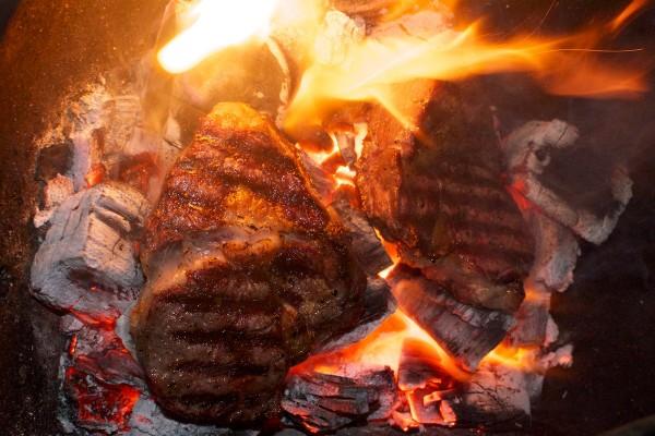 Steaks on coals